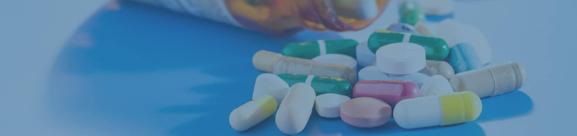 Pills Spilling Onto Table